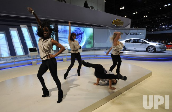 Dancers promote the Chevrolet Volt at the LA Auto Show 2009 in Los Angeles