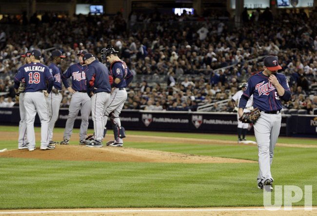 Minnesota Twins starting pitcher Brian Duensing reacts in Game 3 of the 2010 ALDS at Yankee Stadium in New York