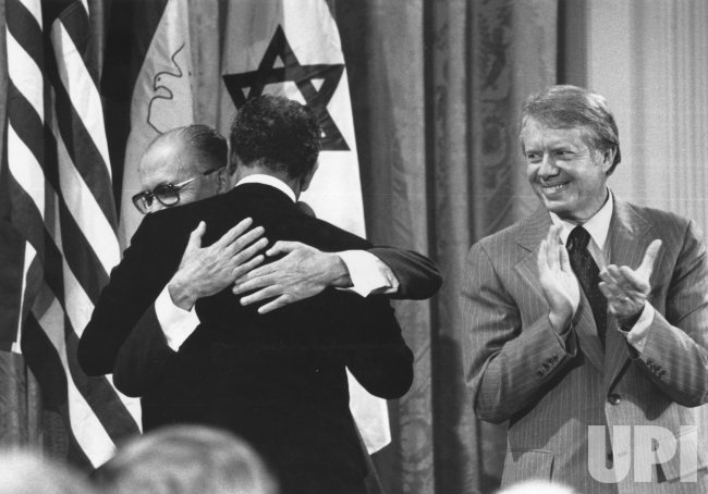 Jimmy Carter, Anwar Sadat and Menachem Begin conclude the Camp David Summit