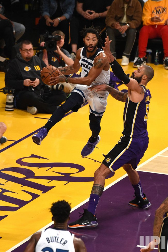 a5d571ac75b Timberwolves guard Derrick Rose hangs in the air by Lakers center Tyson  Chandler