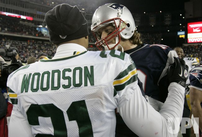 Patriots Brady shakes with Packers Woodson at Gillette Stadium in Foxboro, MA.