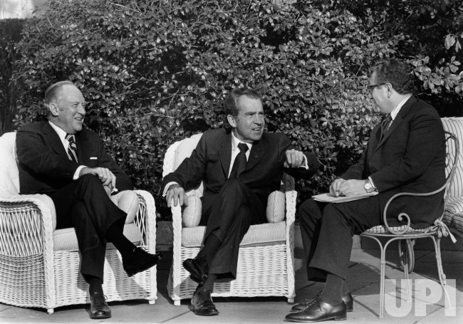William Rogers, Pres. Nixon and Henry Kissinger in the Rose Garden for their meeting