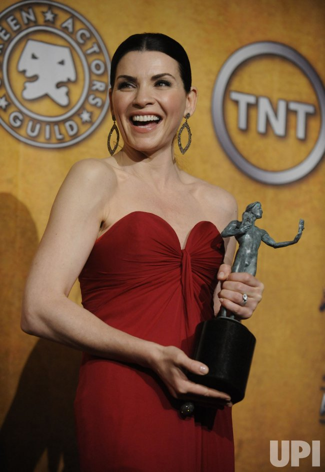 Julianna Margulies poses backstage at the 17th annual Screen Actors Guild Awards in Los Angeles
