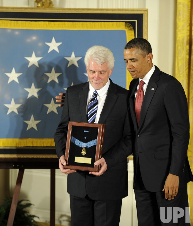 President Obama awards Medal of Honor posthumously to Father Emil Kapaun