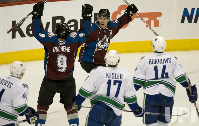Avalanche Duchene and Stastny Celebrate a Goal Against the Canucks in Denver