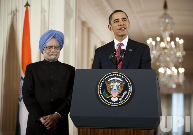 President Obama greets Indian PM Singh in Washington
