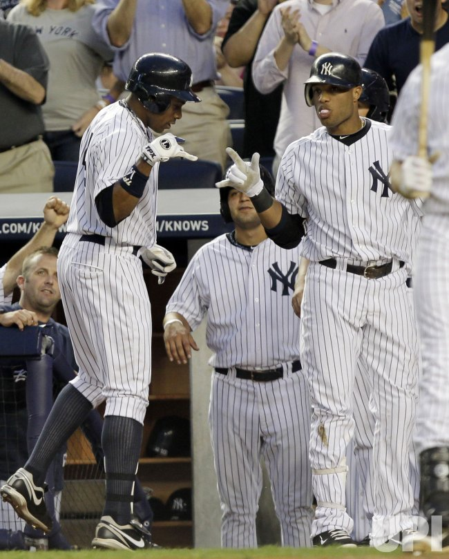 New York Yankees Curtis Granderson reacts with Robinson Cano at Yankee Stadium in New York