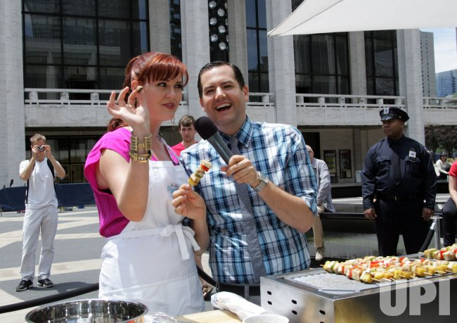 "Sara Rue and Ross Mathews serve and cook food at the Jenny Craig ""Jenny's Party in the Plaza"" in New York"