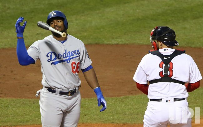 Dodgers' Yasiel Puig reacts after strike three during World Series Game 1