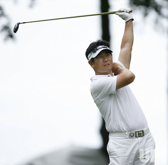 Y. E. Yang tees off on the 13th hole during the final round of the 91st PGA Championship in Chaska, Minnesota