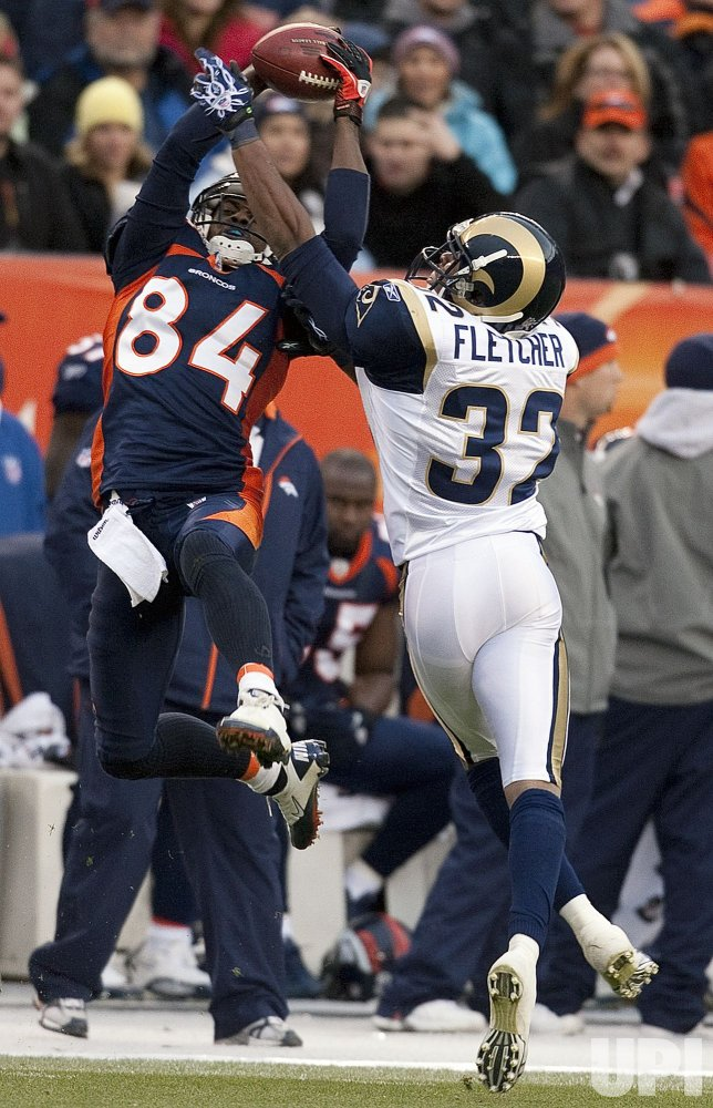Rams Fletcher Breaks Up a Pass Intended for Broncos Lloyd in Denver