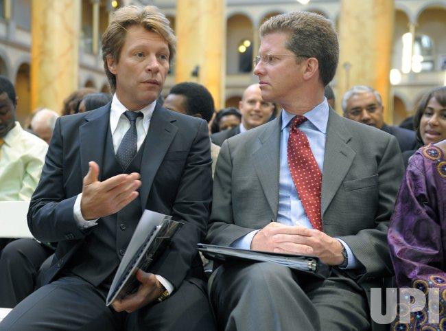 Singer Bon Jovie talks to HUD Secretary Shaun Donovan at the United Nations World Habitat Day Celebration in Washington