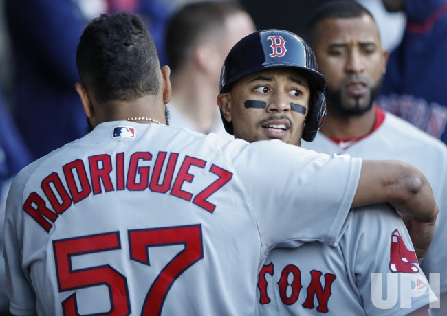 Red Sox Mookie Betts celebrates after scoring against White Sox in Chicago