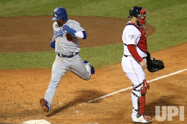 Dodgers' Brian Dozier scores against Red Sox during World Series Game 1