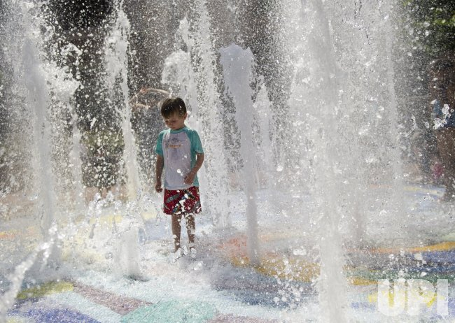 Children play in a Fountain to Escape the Hot Weather in Washington