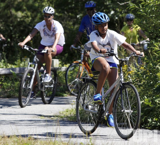 First Lady Michelle Obama biking on Martha's Vineyard with daughter Sasha