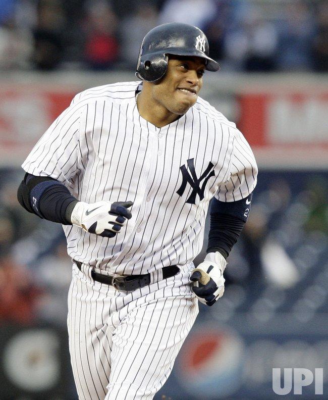 New York Yankees Robinson Cano hits a 2-run homer at Yankee Stadium in New York