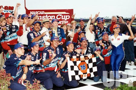 Mark Martin celebrates his victory in the NASCAR UAW-GM Quality 500