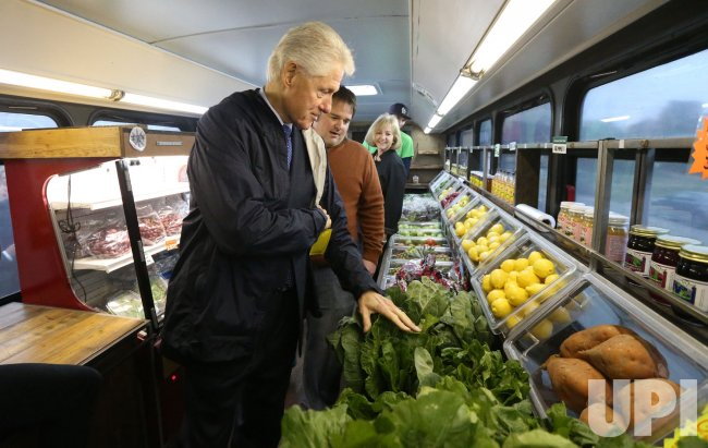 Former U.S. President Bill Clinton tours neighborhood food bus