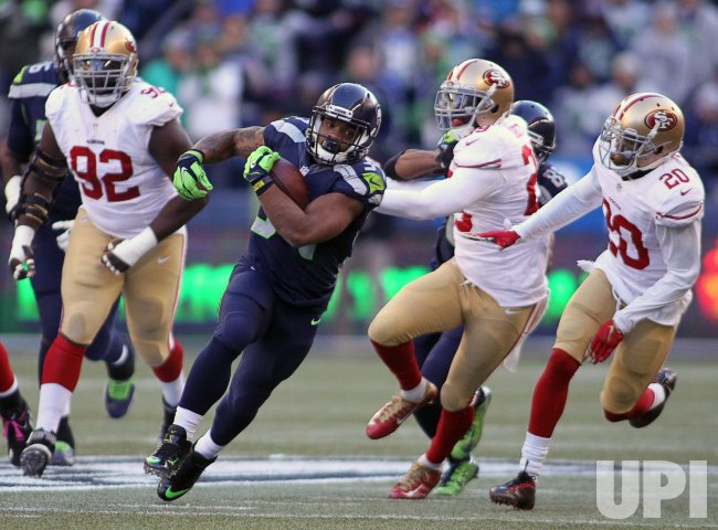 Seattle Seahawks Thomas Rawls sets rookie rushing record with 209 yards against San Francisco 49ers in Seattle