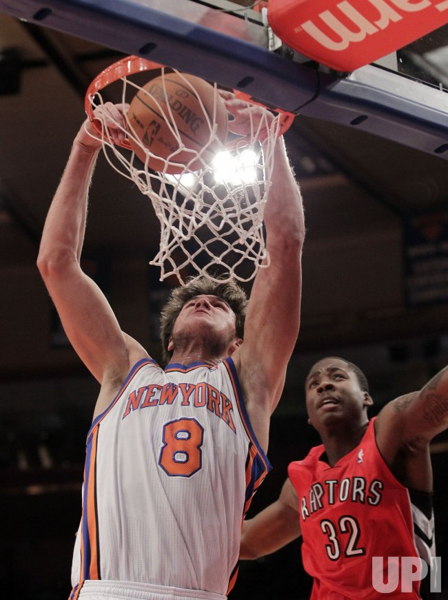 New York Knicks Danilo Gallinari dunks on Toronto Raptors Ed Davis at Madison Square Garden in New York