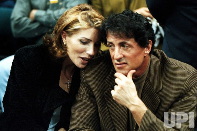 Movie star Sylvester Stallone and wife Jenifer Flavin enjoying the NBA game