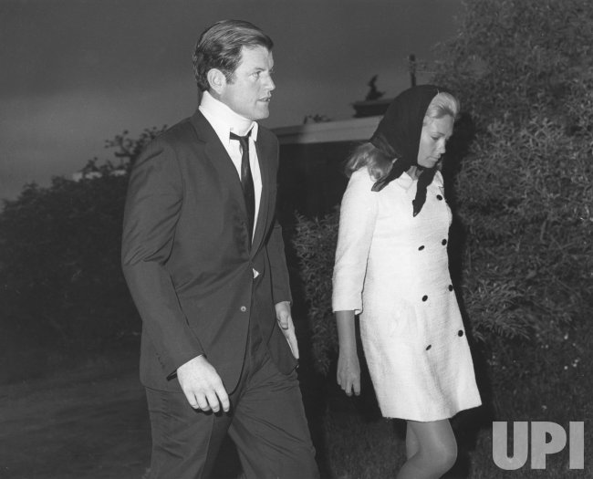 Ted Kennedy and wife Joan leave for the funeral of Mary Jo Kopechne