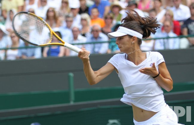 Pironkova plays a forehand at the Wimbledon Championships