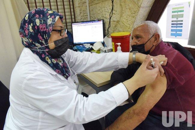 Palestinians Receive COVID-19 Vaccine In East Jerusalem