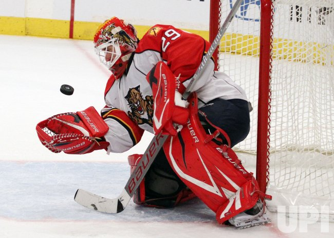 Florida Panthers Tomas Vokoun tries to catch a the puck in his glove against the New York Rangers in the second period at Madison Square Garden in New York
