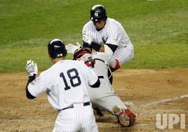 New York Yankees Alex Rodriguez runs into Los Angeles Angels of Anaheim Jeff Mathis at the plate in the fifth inning the game 1 of the ALCS at Yankee Stadium in New York