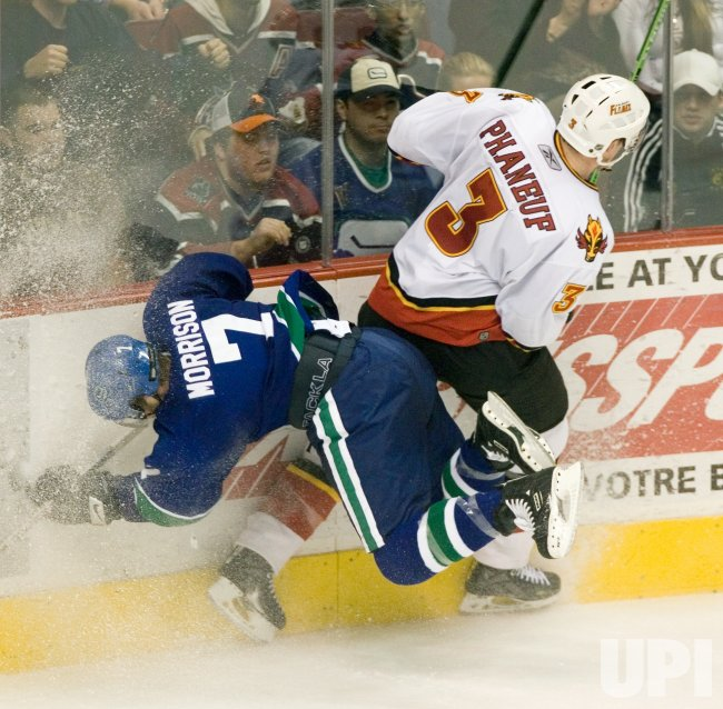 VANCOUVER CANUCKS BEAT CALGARY FLAMES 3-2 IN OVERTIME