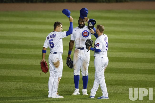 Chicago Cubs celebrate after defeating the Pittsburgh Pirates at Wrigley Field in Chicago
