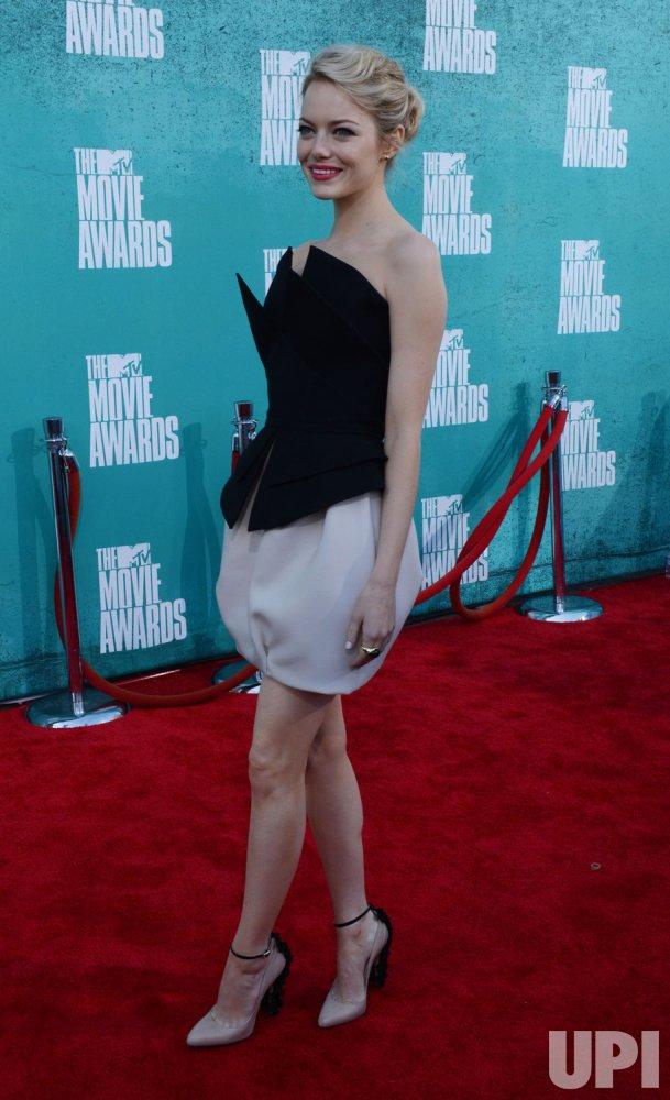 Emma Stone arrives at the 2012 MTV Movie Awards in Universal City, California