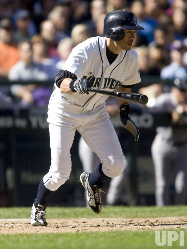 Seattle Mariners' Ichiro Suzuki watches his grounder.