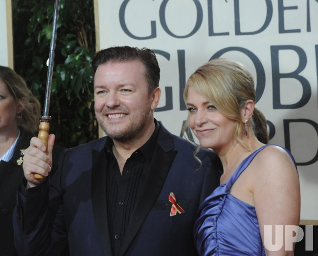 Ricky Gervais and his wife Jane Fallon arrive at the 67th annual Golden Globe Awards