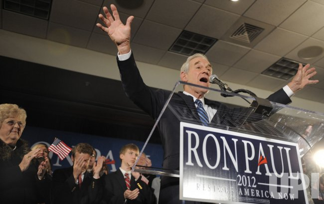 GOP presidential candidate Ron Paul attends a Causcus Night event in Ankeny, Iowa