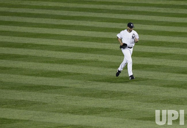 New York Yankees closer Mariano Rivera comes out of the bull pen in Game 5 of the 2010 ALCS at Yankee Stadium in New York