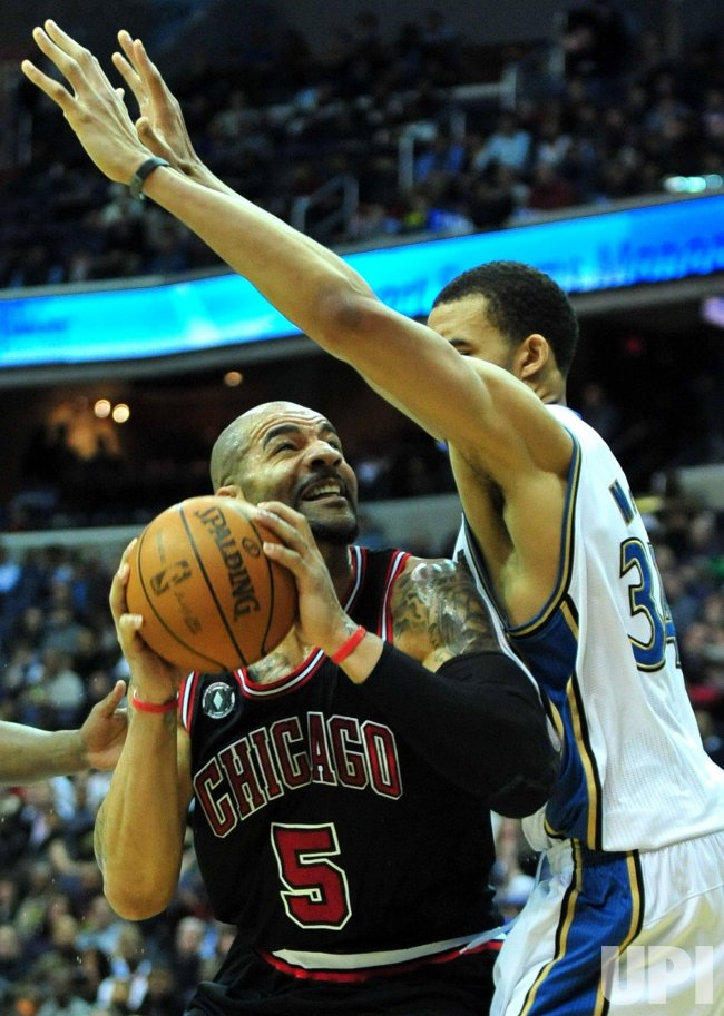 Chicago Bulls' Carlos Boozer shoots against Washington Wizards' JaVale McGee in Washington