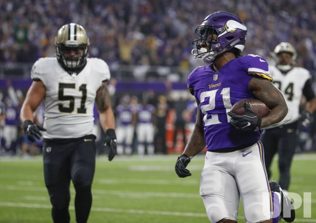 Vikings running back Jerick McKinnon scores a touchdown against the Saints in the NFC Divisional playoff game