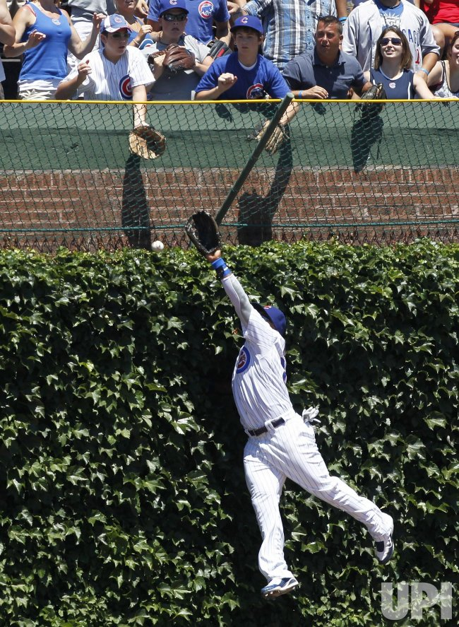 Cubs Byrd misses catch against Reds in Chicago