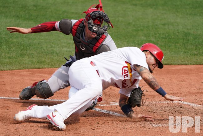 St. Louis Cardinals Yadier Molina is Tagged Out At Home