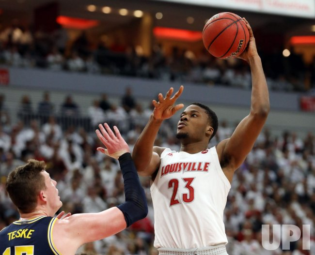 Louisville's senior center, Steven Enoch played very well, as he had a solid all-around game in his team's victory over Michigan. (Photo: John Sommers II/UPI)