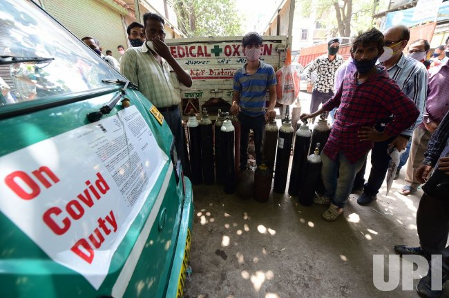 Families Wait for Oxygen in India