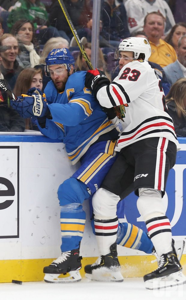 St. Louis Blues Alex Pietrangelo is checked by Chicago Blackhawks Brandon Manning
