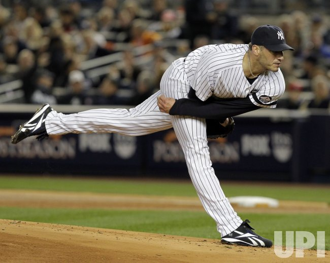 New York Yankees starting pitcher Andy Pettitte throws a pitch in Game 3 of the 2010 ALCS at Yankee Stadium in New York