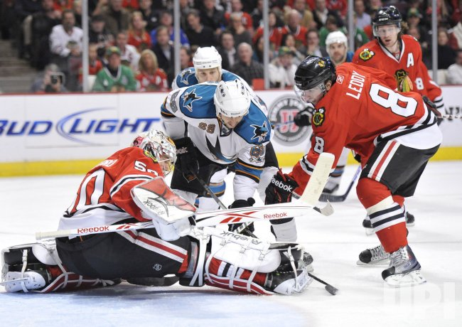 Blackhawks Crawford makes save on shot by Sharks Desjardins in Chicago