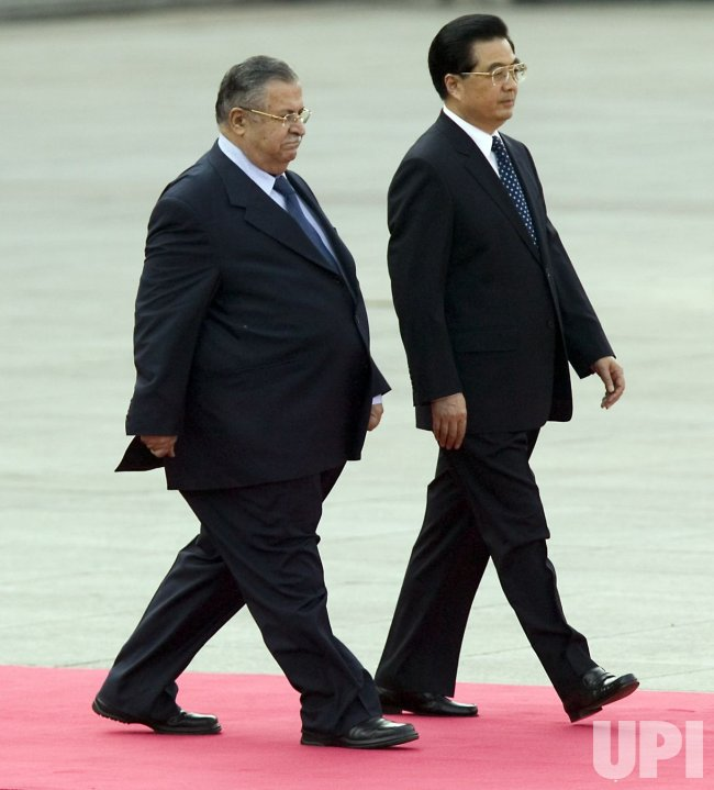 IRAQI PRESIDENT AND CHINESE PRESIDENT HU JINTAO AT WELCOMING CEREMONY IN BEIJING