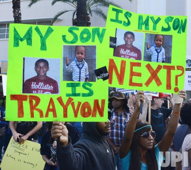 Demonstrators march in Los Angeles protesting George Zimmerman acquital