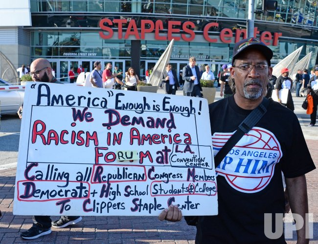 Demonstrators protest Clippers owner Donald Sterling outside the Staples Center at Game five of the NBA playoffs in Los Angeles